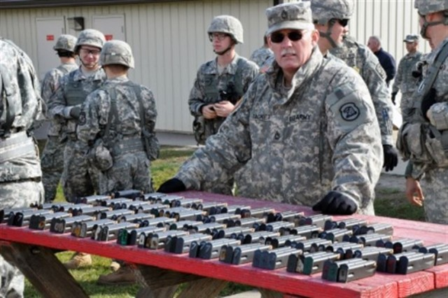 Army Sgt. 1st Class Harold G. Tackett, 51, the senior supply sergeant at Joint Forces Headquarters, Iowa National Guard, prepares to issue ammunition during the German Armed Forces Badge for Military Proficiency competition held at Camp Dodge, Johnston, Iowa, Nov. 8, 2014.
