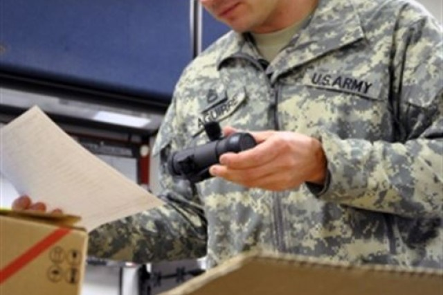 Army Sgt. 1st Class Daniel Aguirre, 33, a Joint Forces Headquarters, Iowa National Guard supply sergeant from Altoona, Iowa, checks incoming equipment against the inventory checklist, Oct. 30, 2015.