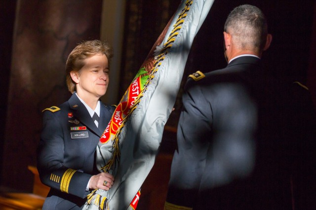 Brig. Gen. Diana Holland receives the colors from U.S. Military Academy at West Point, N.Y. Superintendent Lt. Gen. Robert L. Caslen as she assumes command of the U.S. Corps of Cadets, Jan. 5, 2016. Holland became West Point's 76th commandant and the first female to serve in the position.