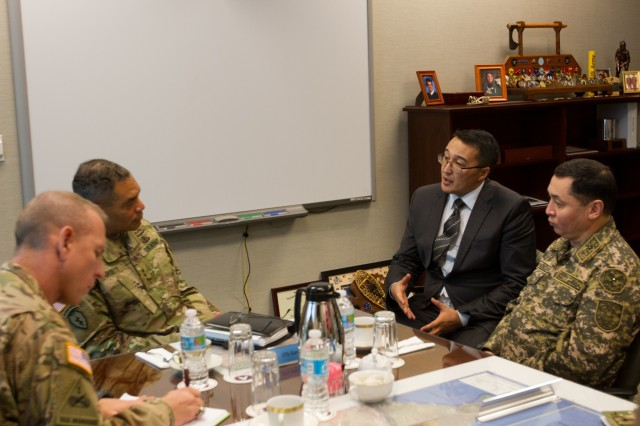 Lt. Gen. Michael X. Garrett, second from left, commanding general of U.S. Army Central, or USARCENT, and Command Sgt. Maj. Ronnie R. Kelley, senior enlisted adviser, USARCENT, confer with Gen. Maj. Mukhamedzhan Talasov, deputy chairman of the general staff for Kazakhstan armed forces, during a recent visit at USARCENT's Shaw headquarters.