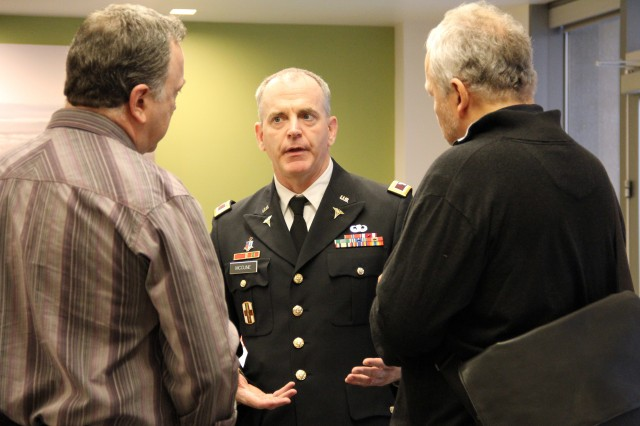Col. David McCune (center), research consultant, Western Regional Medical Command, speaks to two health care entrepreneurs in a recent panel discussion during Seattle Startup Week.