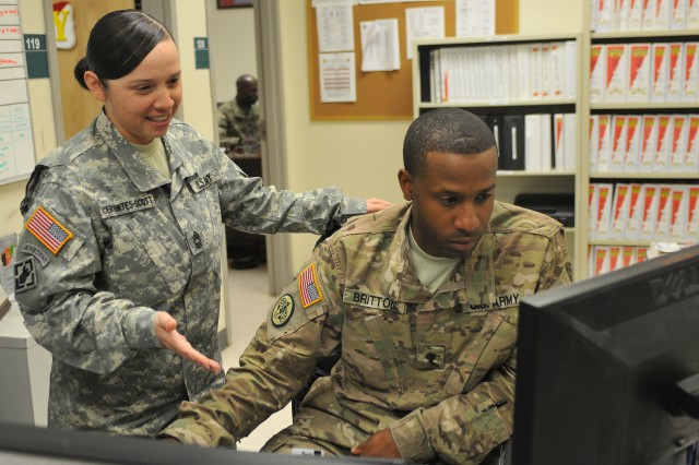 Spc. Tamarkion Britton (right) works on his plan to achieve his New Year's resolution with Master Sgt. Tracy Cervantes-Scott, both Troopers with 3d Cavalry Regiment, at the regimental headquarters building Jan. 5 at Fort Hood, Texas. His resolution for the new year is self-improvement. (Photo by Staff Sgt. Tomora Clark 3d Cav. Regt. Public Affairs NCOIC)