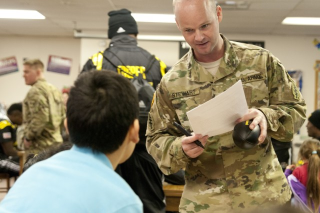 Sgt. 1st Class Ryan Stewart, a Soldier with the U.S. Army Special Operations Command, tests the knowledge of a student at Boysville in San Antonio, Jan. 5, 2016.