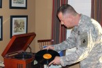 As part of his collection, Chaplain (Maj.) Jeffrey Roberson has more than 500 records, a modern record player and three 20th century players that date as far back as 1925. His goal is to one day own an Edison.