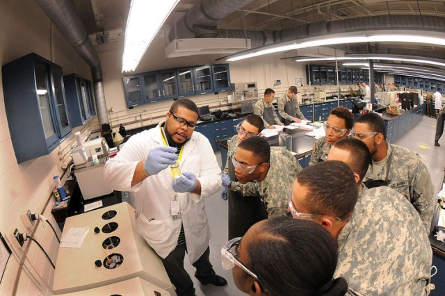Petroleum Laboratory Specialist Course instructor Darius Martin explains the results of a fuel test Dec. 10 as students look on. The course is approximately 11 weeks long and is taught by the Quartermaster School's Petroleum and Water Department.