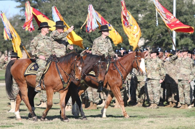Maj. Gen. J.T. Thomson (left to right), 1st Cavalry Division commanding general, Maj. Gen. Michael Bills, outgoing CG, and Lt. Gen. Sean MacFarland, III Corps and Fort Hood commanding general, ride horseback as they inspect the division during a change of command ceremony on Cooper Field at Fort Hood, Texas, Jan. 7. (U.S. Army photo by Staff Sgt. Christopher Calvert, 1st Cavalry Division Public Affairs (released))