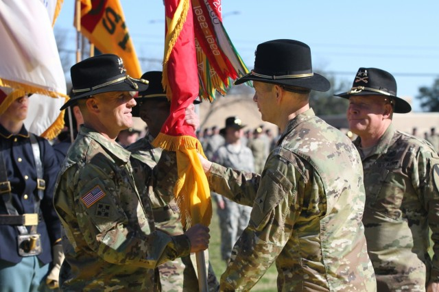 Maj. Gen. J.T. Thomson (left), 1st Cavalry Division commanding general, receives the division colors from Lt. Gen. Sean MacFarland (center), III Corps and Fort Hood commanding general, as Maj. Gen. Michael Bills, outgoing 1st Cavalry Division CG, looks on during a change of command ceremony on Cooper Field at Fort Hood, Texas, Jan. 7. (U.S. Army photo by Staff Sgt. Christopher Calvert, 1st Cavalry Division Public Affairs (released))