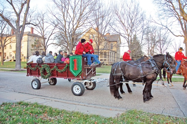 Fort Riley, Kansas, community members took a carriage ride put on by the Commanding General's Mounted Color Guard before the Christmas Eve service at the historic Main Post Chapel at Fort Riley.