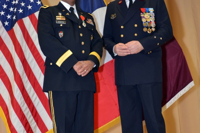Brig. Gen. Norvell V. Coots, Regional Health Command Europe commander, and Maj. Gen. Patrick Godart, French Defense Medical Services deputy surgeon general, pose for photos after Coots Received the French Legion of Honor from Godart at Landstuhl Regional Medical Cent Jan. 7.  The Legion of Honor is France's highest award and was presented to Coots for his support of France and the French military medical services.  (U.S. Army photo by Ed Drohan, Regional Health Command Europe Public Affairs)