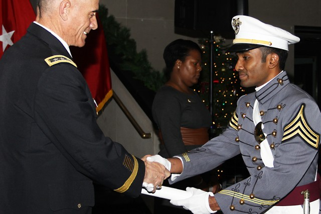 U.S. Military Academy at West Point Superintendent Lt. Gen. Robert L. Caslen Jr. presents Class of 2015 Cadet Mohamed Naif, an international exchange student from the Republic of the Maldives,  his diploma Dec. 18 at Eisenhower Hall's Crest Hall (U.S. Army photo by Kathy Eastwood, USMA at West Point, Public Affairs/released.)