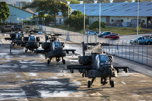 Aircrews, from 16th Combat Aviation Brigade, and their AH-64E Apache Guardians prepare to take off from Joint Base Pearl Harbor Hickam on their way to Wheeler Army Airfield to train with 2-6 Cavalry, 25th Combat Aviation Brigade, Jan. 6, 2016.