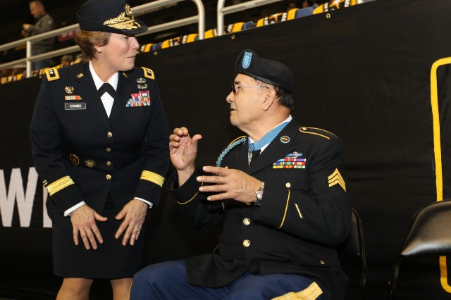 Maj. Gen. Peggy Combs, commander of U.S. Army Cadet Command and Fort Knox, visits with Medal of Honor recipient Army Sgt. Santiago Erevia before the U.S. Army All-American Bowl.