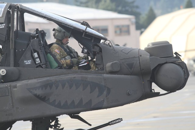 A U.S. Army AH-64E Apache pilot assigned to 1-229th Attack Reconnaissance Battalion, 16th Combat Aviation Brigade, 7th Infantry Division prepares to depart from Joint Base Lewis-McChord, Washington for the National Training Center Jan. 9, 2016. The Soldiers and aircraft will participate in training with other units from 7th Infantry Division to prepare for future missions.