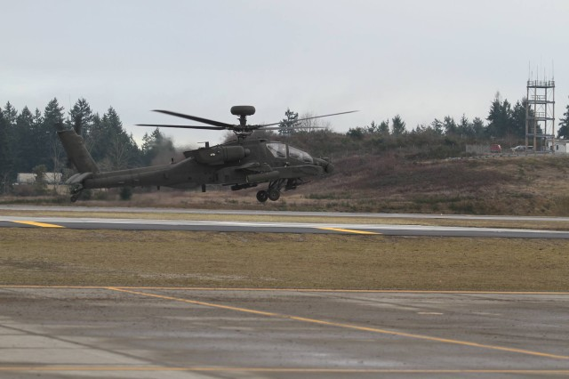 A U.S. Army AH-64E Apache assigned to 1-229th Attack Reconnaissance Battalion, 16th Combat Aviation Brigade, 7th Infantry Division prepares to depart from Joint Base Lewis-McChord, Washington for the National Training Center Jan. 9, 2016. The Soldiers and aircraft will participate in training with other units from 7th Infantry Division to prepare for future missions.