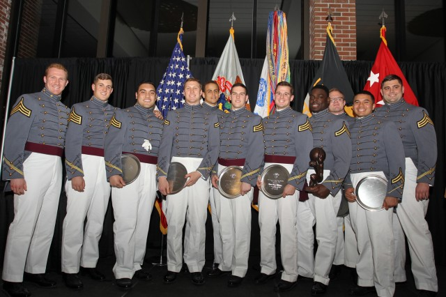 Army football U.S. Military Academy at West Point Cadets pose with their awards given to them at a post season banquet, in Eisenhower hall, Jan. 9. At this banquet Army football head coach Jeff Monken spoke about the 2015 season, expectations for the upcoming season and helped hand out varsity letters, senior accolades and 10 awards. (Photo by Army West Point Athletics/all rights reserved.)