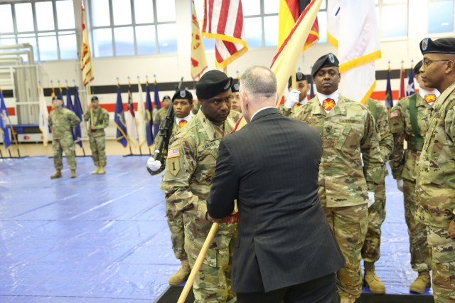 Michael Formica, director of IMCOM Europe, presents the organization's guidon to Command Sgt. Maj. Gene Canada during the region's change of responsibility ceremony.