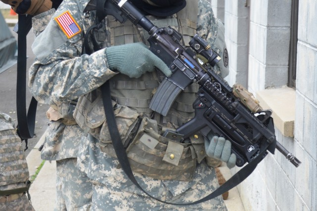 A New York Army National Guard Soldier, assigned to Company A, 1st Battalion 69th Infantry, checks a corner while training at the New York Police Department's urban training facility at Rodman's Neck in New York, Jan. 9, 2016.