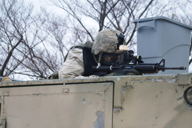 A New York Army National Guard Soldier, assigned to Company A, 1st Battalion 69th Infantry, sets up an overwatch position while training at the New York Police Department's urban training facility at Rodman's Neck in New York, Jan. 9, 2016.