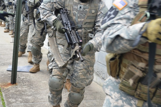 New York Army National Guard Soldiers, assigned to Company A, 1st Battalion 69th Infantry, move out while training at the New York Police Department's urban training facility at Rodman's Neck in New York, Jan. 9, 2016.