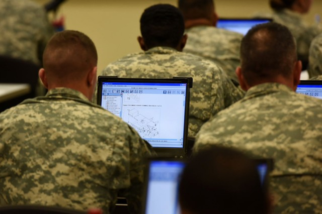 Soldiers from the 10th Mountain Division explore the Maintenance Support Device's enhanced equipment schematics during classroom instruction at Fort Drum, New York, Dec. 7-11. (Photo by Michael Satchfield, TACOM EMS-NG)