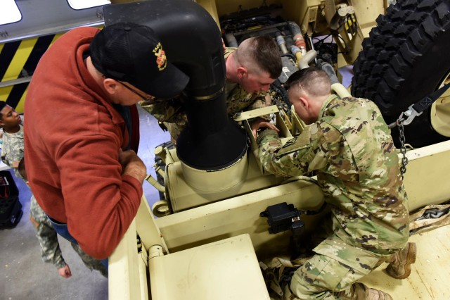 Soldiers from the 10th Mountain Division conduct maintenance with guidance from Tank-Automotive and Armament Command Logistics Assistance Representative, Robert Evans, at Fort Drum, New York, Dec. 7-11.  (Photo by Michael Satchfield, TACOM EMS-NG)