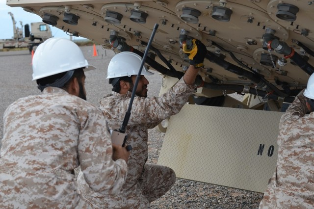 United Arab Emirates airmen check cable serviceability as part of an emplacement drill during training on the Terminal High Altitude Area Defense system at White Sands Missile Range, N.M. The THADD training was conducted by Technical Assistance Fielding Team members from the U.S. Army Security Assistance Training Management Organization. Eighty-one UAE officers and airmen underwent 32 weeks of intense training on THAAD before their Dec. 9 graduation.