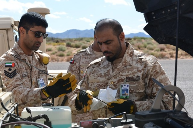 United Arab Emirates airmen conduct preventative maintenance checks and services as part of Terminal High Altitude Area Defense training at White Sands Missile Range, N.M.
