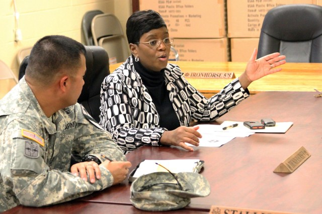 Debbi Nash-King, right, Family readiness support assistant, 1st Armored Brigade Combat Team, or ABCT, 1st Cavalry Division, meets with Sgt. 1st Class Gregory Ramirez, Family readiness leader, or FRL, 2nd Battalion, 5th Cavalry Regiment, 1st ABCT, and other FRLs, Jan. 7, 2016, to discuss Family readiness throughout the brigade.