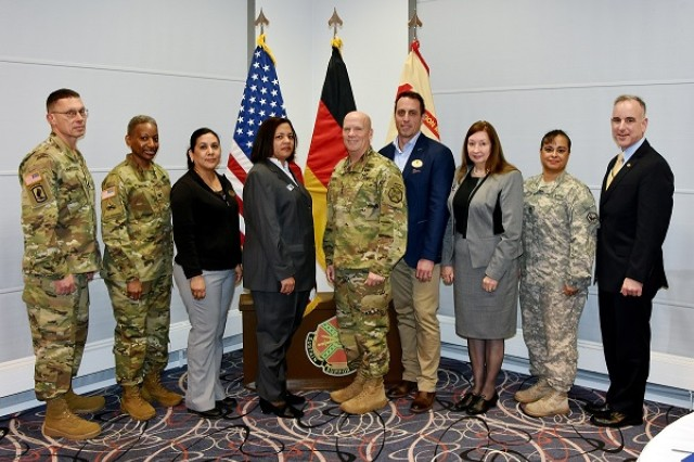 Photo cutline: Lt. Gen. Kenneth R. Dahl, U.S. Army Installation Management Command commanding general; Michael Formica, IMCOM -- Europe regional director; Col. Mary Martin, U.S. Army Garrison Wiesbaden commander; and Command Sgt. Maj. Jeffery Hartless, IMCOM command sergeant major; stand for a group photo with Cecilia Kandler, Family and MWR Child, Youth and School Services coordinator; Sgt. 1st Class Jinet Velez, Soldier For Life — Transition Assistance Program, noncommissioned officer; Felix Bartels, acting Department of Public Works O&M chief; Katherine Vahrenkamp, director, Hainerberg School Age Center; and Ana Cutler, Department of Plans, Training, Mobilization and Security;  after the USAG Wiesbaden members received commander's coins from Dahl during his visit Jan. 11.