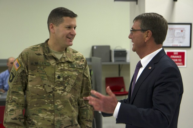 U.S. Secretary of Defense Ashton B. Carter catches up with former student, Lt. Col. Zachary Miller, during a visit to Fort Campbell, Kentucky, Jan. 13, 2016. Miller attended a Defense Policy class at Harvard University which was taught by Carter. Carter, now the SecDef, visited Fort Campbell Soldiers to talk about upcoming deployments and to thank 101st Airborne Division (Air Assault) Soldiers for their sacrifices. (U.S. Army photo by Sgt. William White)