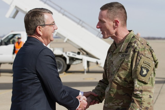 Secretary Of Defense Ashton B. Carter meets with Maj. Gen. Gary J. Volesky after his arrival to Fort Campbell, Kentucky, home of the 101st Airborne Division (Air Assault), Jan. 13, 2016. Carter visited 101st Airborne Division Soldiers to talk about the threat of ISIL before their upcoming deployment. (U.S. Army photo by Sgt. William White)