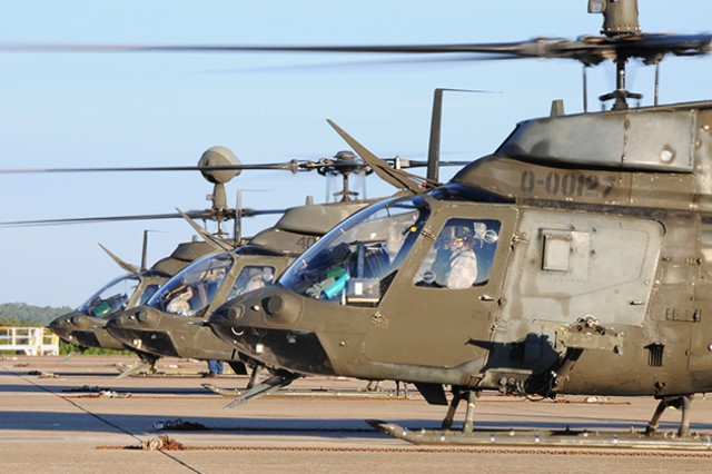 In a file photo, three OH-58D Kiowa Warriors prepare to leave Fort Rucker, Ala., for the last time at Hanchey Army Airfield, Nov. 18, 2014.