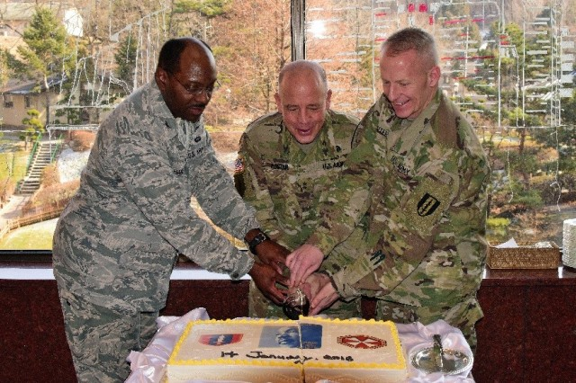 Maj. Gen. David W. Puster, Eighth Army deputy commanding general (sustainment); U.S. Forces Korea Joint Cyber Center director Air Force Col. Dexter F. Harrison; and 1st Signal Brigade deputy commander Lt. Col. Dean Denter conduct a ceremonial cake cutting at Yongsan Garrison in Seoul, South Korea, Jan. 14, 2016, to celebrate the birthday of Dr. Martin Luther King Jr.