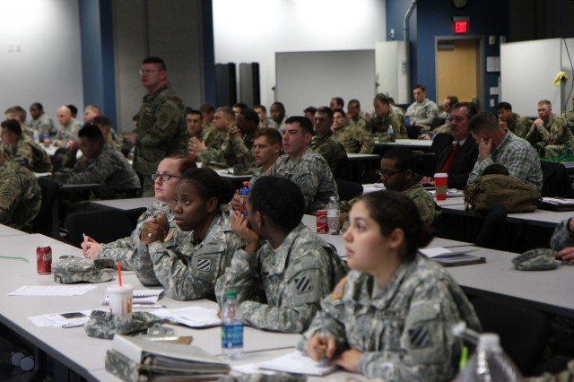 Soldiers, of 2nd Infantry Brigade Combat Team, 3rd Infantry Division, listen to an introductory course during a command post exercise at the Mission Training Complex on Fort Stewart, Ga., Jan. 13, 2016.