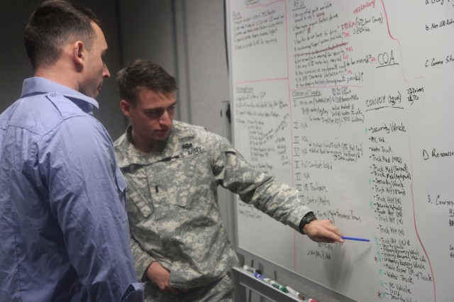 Soldiers, of 2nd Infantry Brigade Combat Team, 3rd Infantry Division, review plans during a command post exercise at the Mission Training Complex on Fort Stewart, Ga., Jan. 13, 2016.