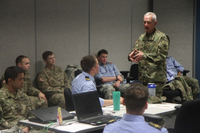 Brig. Gen. Jon A. Jensen, deputy commanding general of U.S. Army Africa, gives advice to the staff of 2nd Infantry Brigade Combat Team, 3rd Infantry Division, about planning for upcoming accords-series exercises during a command post exercise at the Mission Training Complex on Fort Stewart, Ga., Jan. 13, 2016.