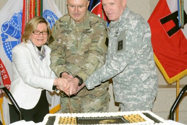 Patti Miller (left), a veteran of the civil rights movement, joins First Army Commanding General, Lt. Gen. Michael S. Tucker (center) and First Army Command Sgt. Maj. Sam Young to slice the cake during a Martin Luther King Jr. Day ceremony in Heritage Hall on Rock Island Arsenal, Ill., on Jan. 19.