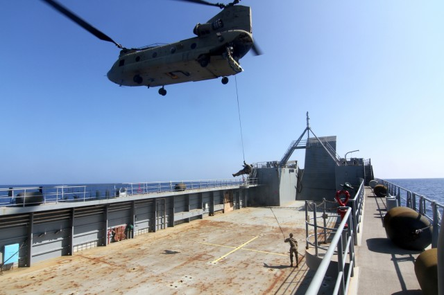 Soldiers, with 25th Infantry Division, conduct air assault operations onto the deck of the 8th Theater Sustainment Command's Logistical Support Vessel-2, CW3 Harold C. Clinger, off the coast of Honolulu, Jan. 12, 2016.