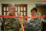 Col. Joseph Holland, garrison commander and 1st Lt. Michele Ramsel, Tax Center officer in charge cut the ribbon to signify the opening of the Humphreys Tax Center on Jan. 20. The Tax Center is located on the first floor of the Legal Assistance Center.