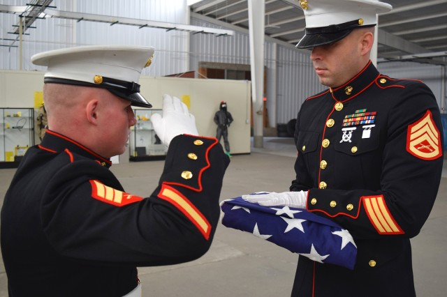 Marine Sgt. Dwight Waggoner and Marine Staff Sgt. Joseph Rodriguez, Marine Corps Detachment on Fort Leonard Wood, practice the flag-folding portion of the funeral ceremony for an upcoming funeral.