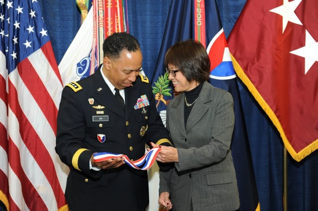 Army Materiel Command's Commander Gen. Dennis L. Via presents Heidi Shyu with the Gen. Brehon B. Somervell Medal of Excellence during a farewell ceremony at AMC headquarters. Shyu, assistant secretary of the Army for acquisition, logistics and technology, will retire Jan. 30.