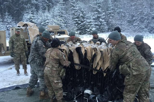 Paratroopers from the multifunction platoon set up a tent system, Jan. 15, 2016, at Training Site Number Two from Camp Algier, Germany.