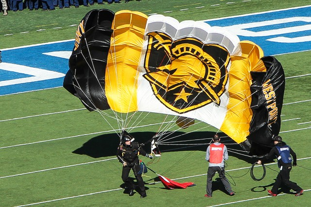 "Class of 2016 Cadet Jordan Komm jumps into Falcon Stadium on game-day of the Army-Air Force Football game in November. Komm was named ""Most Competitive Collegiate Skydiver"" during the National Collegiate Parachuting Championships Dec. 21, 2015-Jan. 3, 2016 (U.S. Army photo by Michelle Eberhart USMA West Point Public Affairs/released.)"