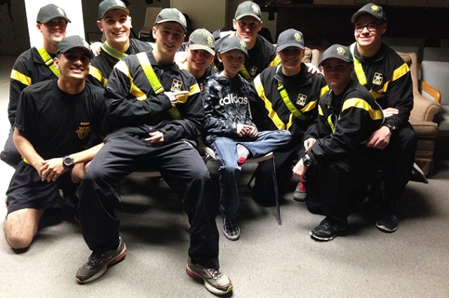 Andrew, a young man adopted by the West Point Parachute Team, sits with the newest members of the squad (Courtesy photo/all rights reserved.)
