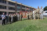 The commanding general of the 8th Theater Sustainment Command, Major General Edward F. Dorman III, and the command sergeant major of the 8th TSC, CSM Gregory Binford, gather with the staff directors and command groups that have been critical to the 8th TSC going 1,600 days without a fatal accident.