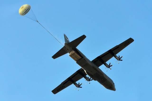 An U.S. Air Force 86th Air Wing C-130 Hercules airdrops a Humvee belonging to the 173rd Airborne Brigade into Frida IV Drop Zone in Pordenone, Italy, Jan. 21, 2016. The 173rd Airborne Brigade is the U.S. Army Contingency Response Force in Europe, capable of projecting ready forces anywhere in the U.S. European, Africa or Central Commands' areas of responsibility within 18 hours. (U.S. Army photo by Visual Information Specialist Paolo Bovo/Released)