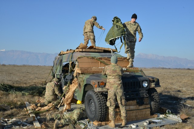 Paratroopers assigned to the 54th Brigade Engineer Battalion, 173rd Airborne Brigade, recover a Humvee after it was airdropped onto Frida IV Drop Zone in Pordenone, Italy, Jan. 21, 2016. The 173rd Airborne Brigade is the U.S. Army Contingency Response Force in Europe, capable of projecting ready forces anywhere in the U.S. European, Africa or Central Commands' areas of responsibility within 18 hours. (U.S. Army photo by Visual Information Specialist Paolo Bovo/Released)