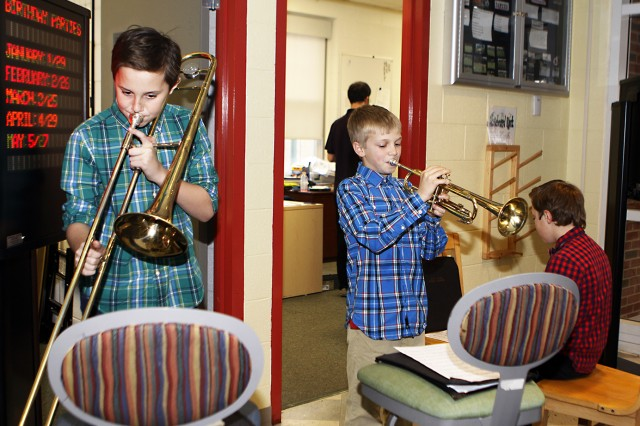 (Left to Right) Bryce Prairie, Hunter Prosperie and Luke Wender entertain participants and attendees of the Boys and Girls Club of America and West Point Youth Services 13th annual Fine Arts Festival at the Middle School Teen Center, Jan. 8 (U.S. Army photo by Kathy Eastwood, USMA West Point, Public Affairs/released.)