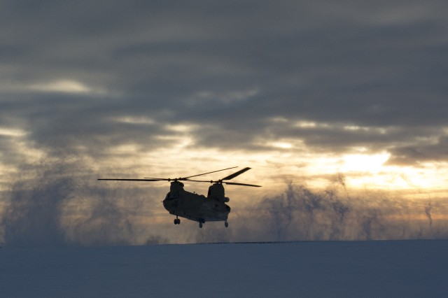 "A CH-47 Chinook Helicopter from Hotel Company, 1st Battalion, 214th Aviation Regiment, 12th Combat Aviation Brigade, ""Big Windy,"" moves into position as part of environmental qualifications and sling-load training at Katterbach Army Airfield, Jan. 20, 2016. (U.S. Army photo by Capt. Jaymon Bell, 12th CAB)"