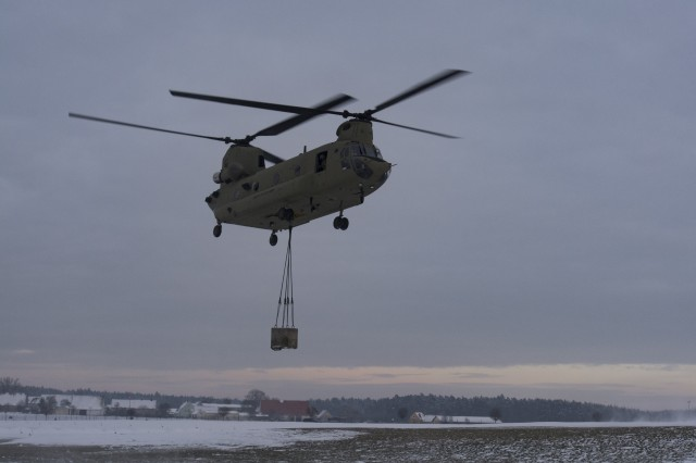 "A CH-47 Chinook Helicopter from Hotel Company, 1st Battalion, 214th Aviation Regiment, 12th Combat Aviation Brigade, ""Big Windy,"" conducts sling-load training at Katterbach Army Airfield, Jan. 20, 2016. (U.S. Army photo by Capt. Jaymon Bell, 12th CAB)"